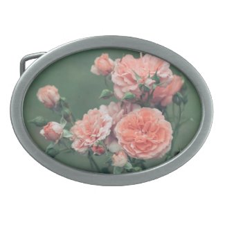Beautiful pink roses on a natural green background belt buckle