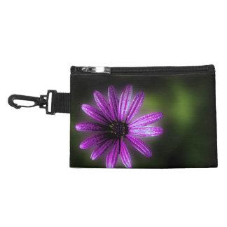 Beautiful purple flower on a travel accessory bag