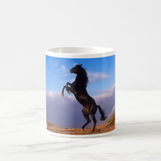 Beautiful rearing black horse with blue sky photo magic mug