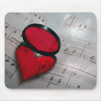 Beautiful red glass reflection forming a heart mouse pads