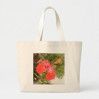 Beautiful Red Hibiscus Flower With Garden Backgrou Large Tote Bag