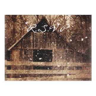 Beautiful  rustic country barn in the snowfall postcard