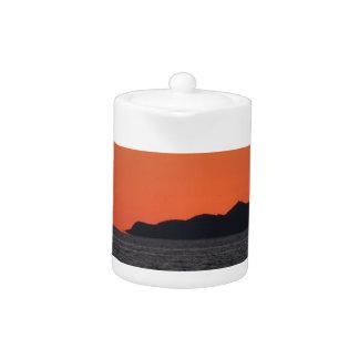 Beautiful sea sunset with island silhouette teapot