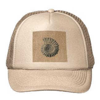 Beautiful seashell design on burlap background trucker hat