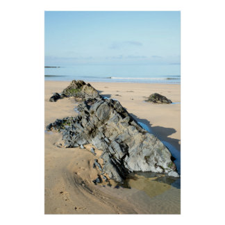 beautiful soft waves break on the black rocks poster