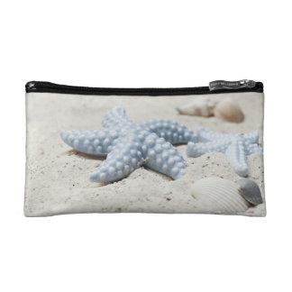Beautiful summer beach sea star shell and sand makeup bag