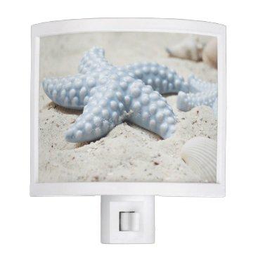 Beautiful summer beach sea star shell and sand night light
