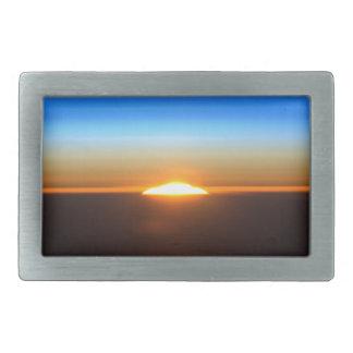 Beautiful sunrise in space rectangular belt buckle