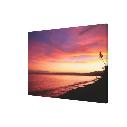 Beautiful sunset at the beach stretched canvas prints