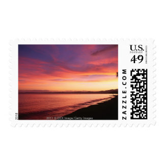 Beautiful sunset at the beach postage