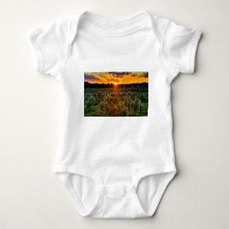 beautiful sunset over farmfield in autumn evening baby bodysuit