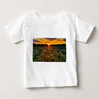 beautiful sunset over farmfield in autumn evening baby T-Shirt