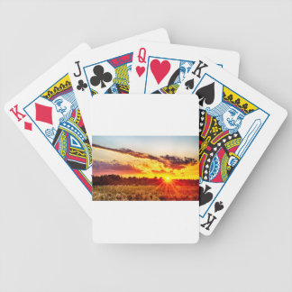 beautiful sunset over farmfield in autumn evening bicycle playing cards