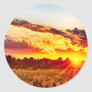beautiful sunset over farmfield in autumn evening classic round sticker