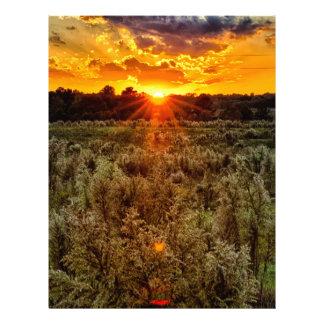 beautiful sunset over farmfield in autumn evening letterhead