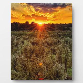 beautiful sunset over farmfield in autumn evening plaque