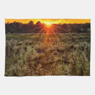 beautiful sunset over farmfield in autumn evening towel