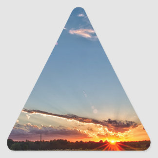 beautiful sunset over farmfield in autumn evening triangle sticker