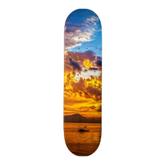 Beautiful Sunset over Lake with Boat Skate Board