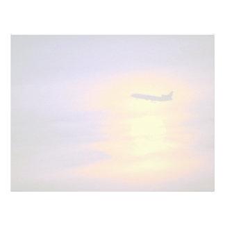 Beautiful Sunset: Passenger jet departing from Tor Letterhead