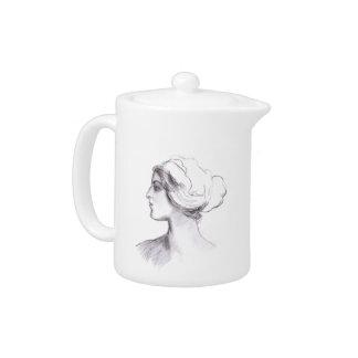 Beautiful teapot with woman's vintage portrait