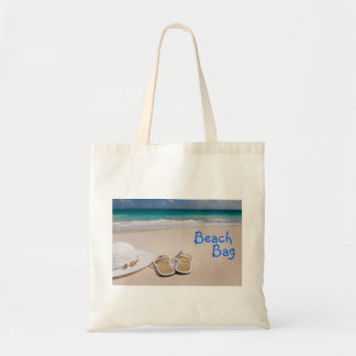 Beautiful tropical beach, flip flops sand and sea tote bag