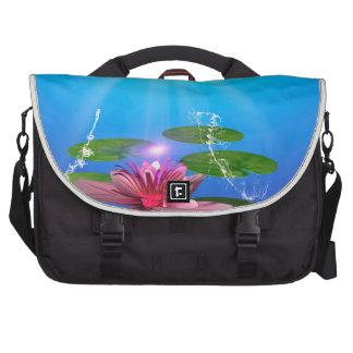 Beautiful water lily with water splash commuter bags