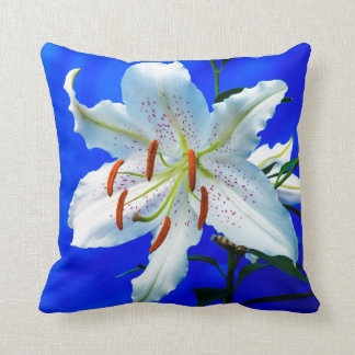 Beautiful White Flower on Royal Blue Background Pillows