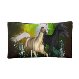 Beautiful wild horses with green, balck background makeup bags