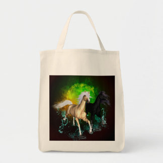 Beautiful wild horses with green, balck background grocery tote bag