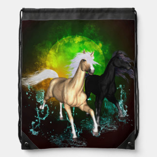 Beautiful wild horses with green, balck background backpacks