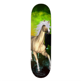 Beautiful wild horses with green, balck background skate board
