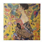 """Beautiful Woman with Fan by Klimt Ceramic Tile<br><div class=""""desc"""">Enjoy this reproduction of the masterpiece Lady with Fan by Gustav Klimt. Completed in 1918, the oil painting depicts a stunning beauty draped in a sensual kimono and holding a fan. Artful Life painstakingly digitally restores these works of art to correct for aging color and vibrancy, while maintaining the lovely...</div>"""