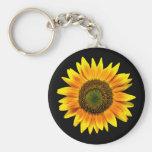 Beautiful yellow sunflower on black keychain