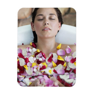 Beautiful young woman relaxing in bathtub with rectangular photo magnet