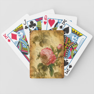 Beautifull pink rose on vintage old wrinkled paper bicycle playing cards