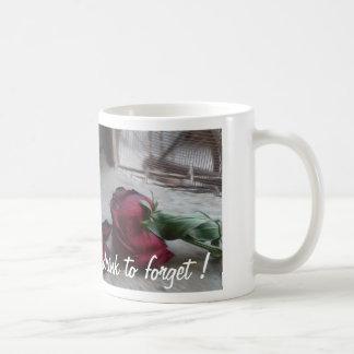 beba para olvidar la taza
