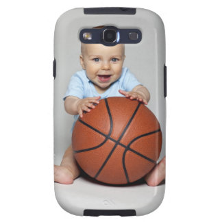 Bebé (6-9 meses) que lleva a cabo baloncesto, galaxy s3 fundas