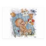 Bebé con los juguetes postales