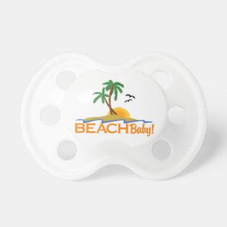 Bebé de la playa chupete