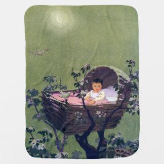 Bebé en cuna en nana del árbol mantas de bebé
