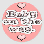 Bebé en la manera pegatina redonda