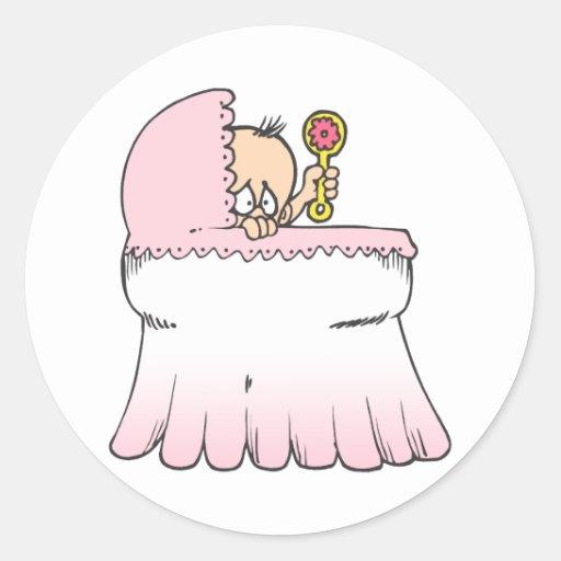 bebé en rosa de la cuna pegatina redonda