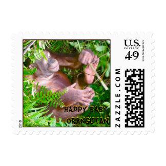 Bebé feliz del orangután en selva tropical sellos