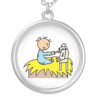 Bebé Jesús que alimenta su collar de las ovejas