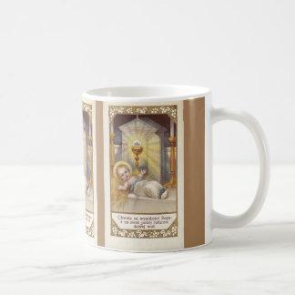 Bebé polaco Jesús en taza del pesebre