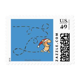 Bebé que corre el mañana de navidad sello postal