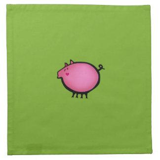 Bebé rosado guarro en verde servilleta