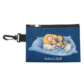 Bebé y perros que duermen en la almohada del perro