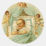 Bebé y querubes del vintage pegatina redonda